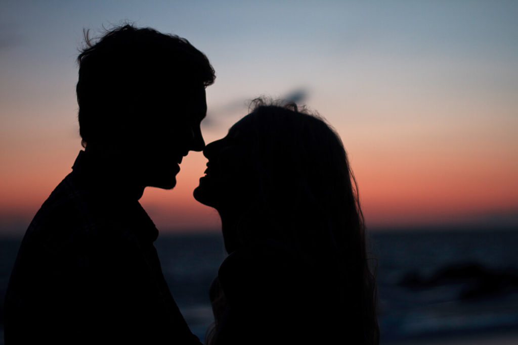 silhouette of couples real close to each other