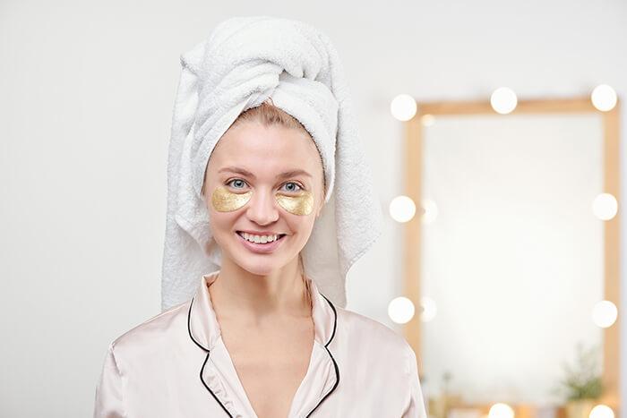 pretty woman wearing eye mask