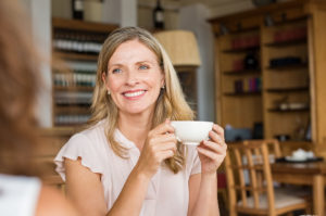 mature woman having coffee with friend
