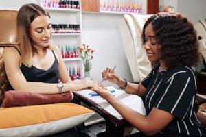 woman enjoying manicure