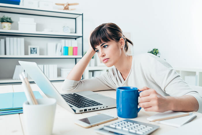 tired woman on her office desk